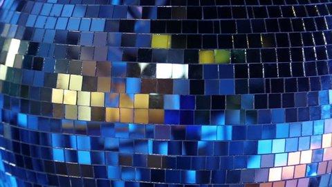 Blue rotating glitterball on the dancefloor