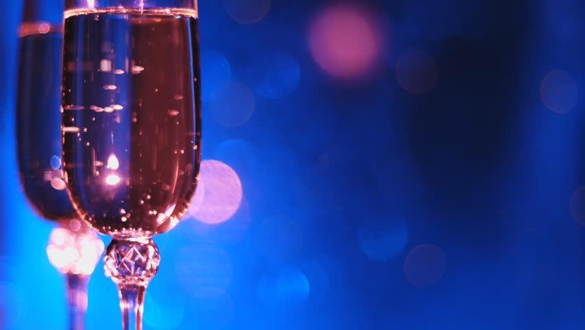 1e0e38716dfa Perfect seamless loop festive background. Wine glass and light garland.