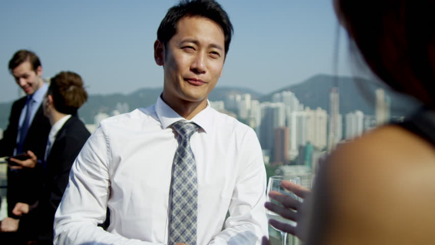 Young ethnic advertising executives talking rooftop bar city downtown multi ethnic colleagues background shot on RED EPIC   Shutterstock HD Video #6434969