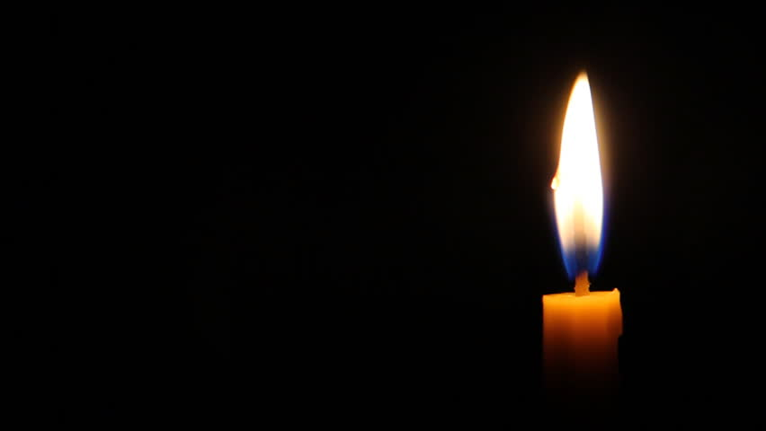 Looping of candle with flickering flame shining in darkness #6464072