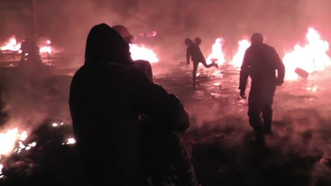 KIEV, UKRAINE - JANUARY 22, 2014: Protesters harness tyres during clashes with police on the street Grushevskogo.