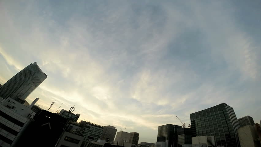 Timelapse view of the sky over the busy megalopolis Tokyo.