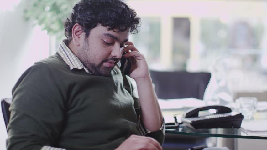 Man on phone in office | Shutterstock HD Video #6495209