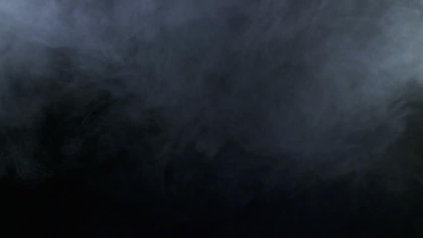 Technology Management Image: Slow Motions Smoke On A Black Background. Professional