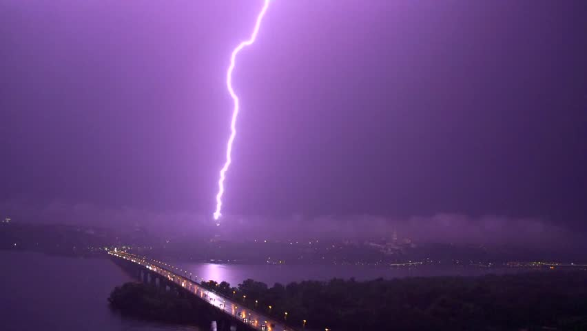 Thunderstorm with lightning in night city. Slow motion video footage 1080p full HD. High speed camera shot