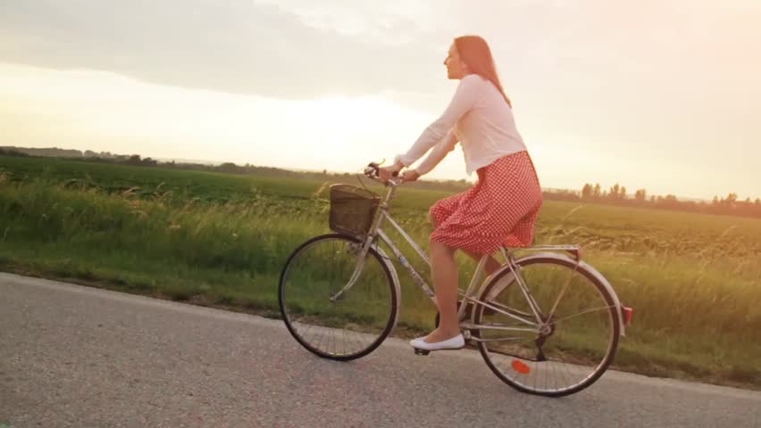 Young Woman Riding Bicycle Summer Dress Field Sunset