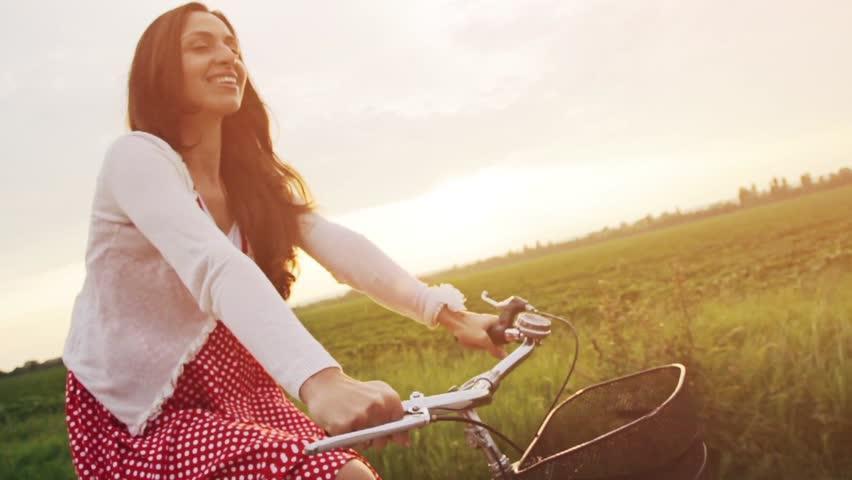 Joyful Young Woman Riding Bicycle Slow Motion Sunset