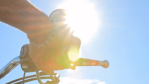 biker starting for a ride accelerates handlebar sun flares