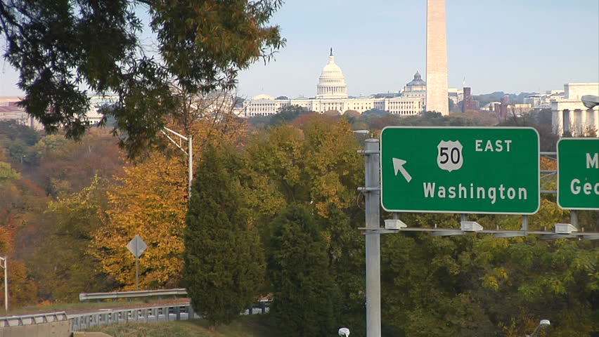 Virginia highway with view of iconic Washington DC landmarks.