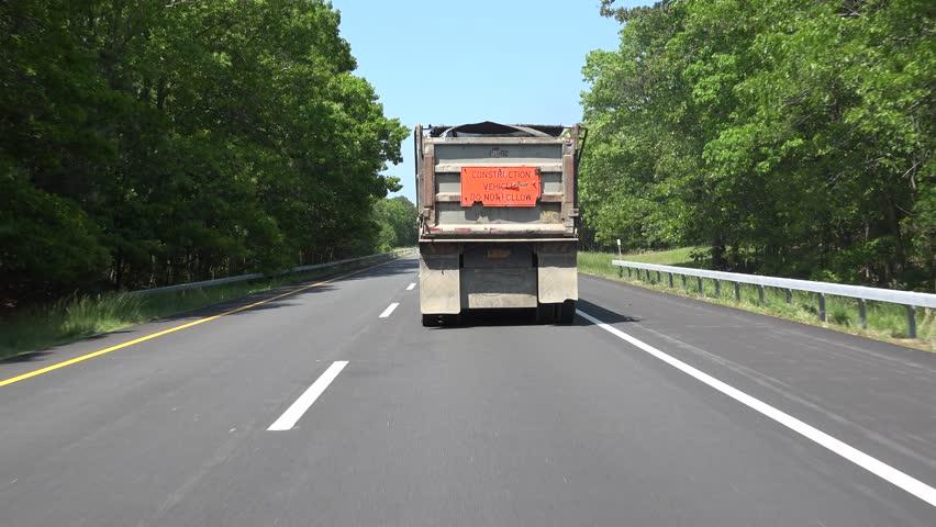 Driving Behind Dump Truck on Highway