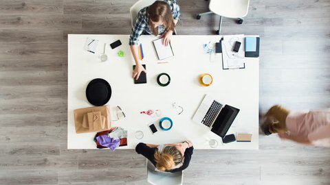 Mixed race group of people aerial view timelapse hipster office small business start up company planning creative meeting