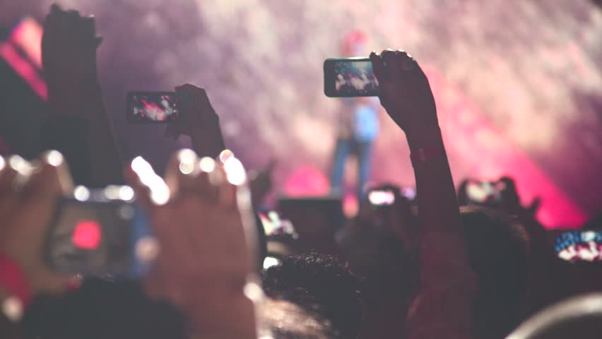 People taking photos or recording video with their smart phones at music concert | Shutterstock HD Video #6632174