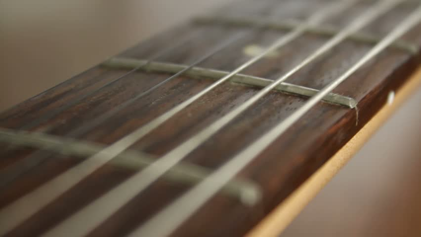 Brown Guitar Neck On The Table Close Up