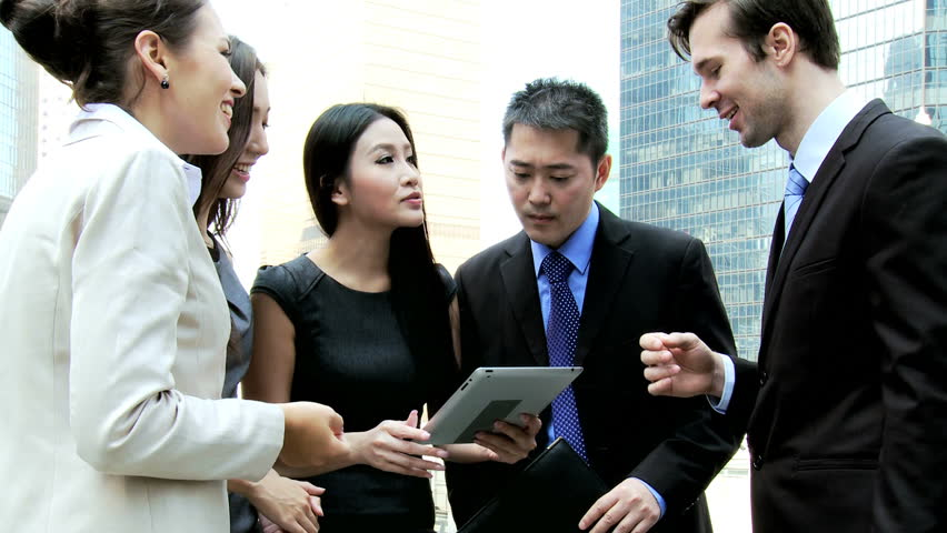 Smart multi ethnic corporate business team wireless mini tablet hot spot outdoors excited good news modern downtown city skyscrapers background | Shutterstock HD Video #6646793