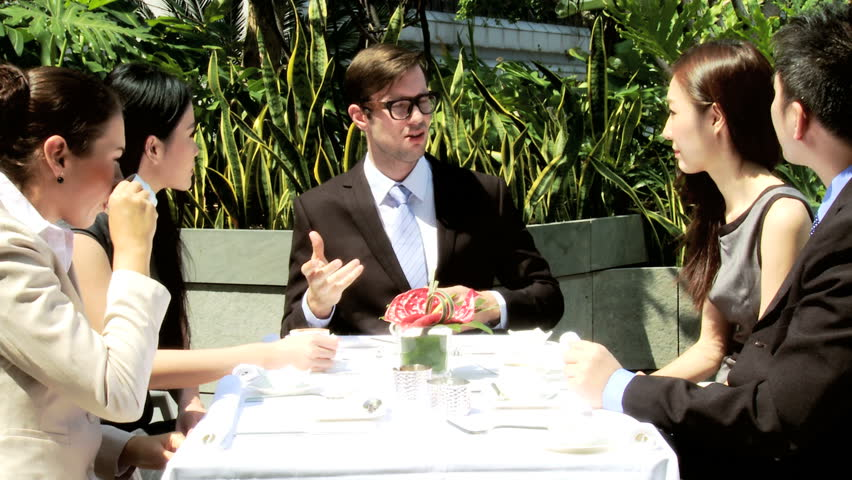 Successful male female Asian Chinese Caucasian advertising executives meeting exploring possible future ventures together outdoors rooftop restaurant | Shutterstock HD Video #6647069