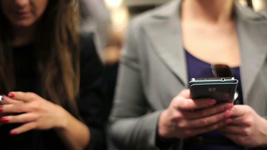 Businesswomen with smartphone riding metro train  | Shutterstock HD Video #6692459