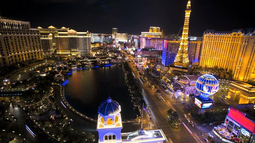 Las Vegas - January 2014: Time lapse illuminated Bellagio Hotel fountain Eiffel Tower Caesars Palace Las Vegas Blvd, Nevada, USA   Shutterstock HD Video #6714025