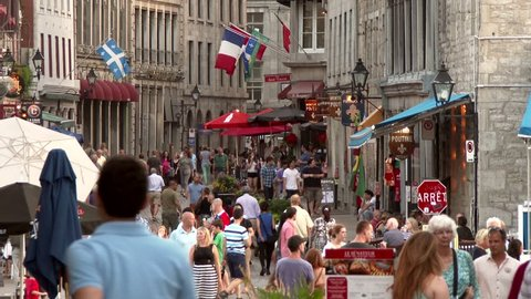 Montreal, Canada - June 2014 - 4K UHD - Busy old european town with tourist shops, restaurants and flags