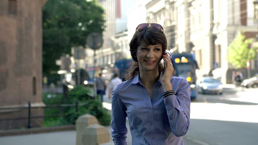 Businesswoman talking on cellphone by the street  | Shutterstock HD Video #6763249