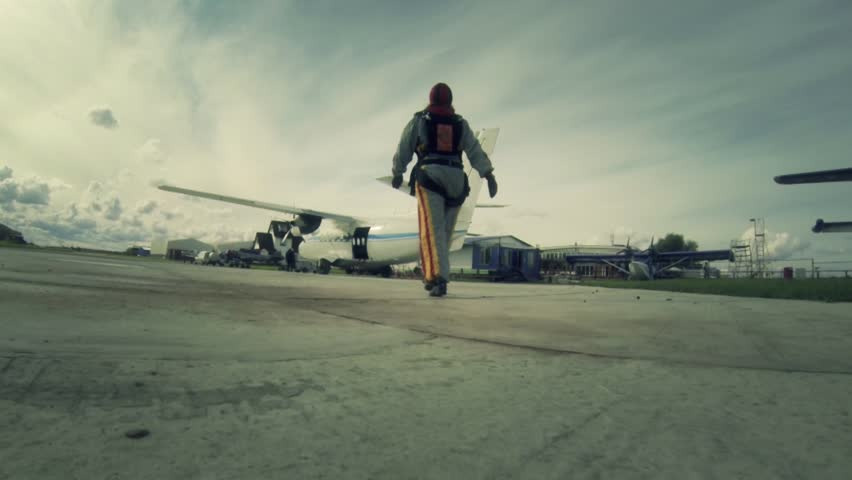 Aerodrome. A woman goes to the plane that would bail out.
