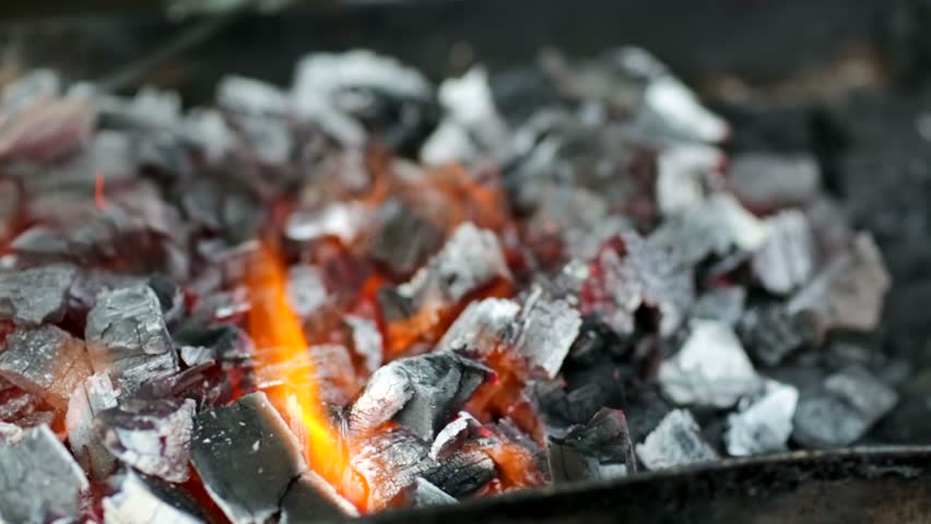 Coals burning in the brazier for barbecue, panning camera. #6778243