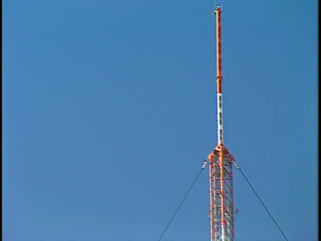 Tall TV tower zoom down. (BetacamSP) | Shutterstock HD Video #68479