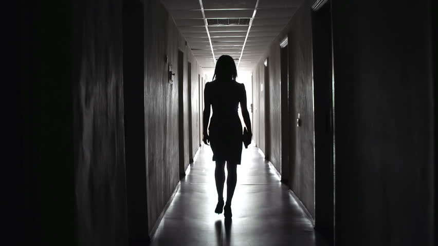 Camera Following Business Like Unrecognizable Lady Tripping Along Dark  Hallway Stock Footage Video 6854329 | Shutterstock