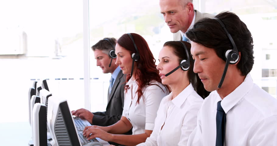 Smiling Business Team Talking On Headset Stock Image