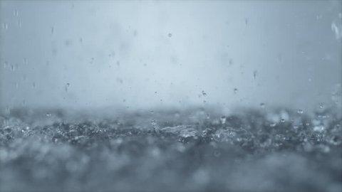 Heavy rain on water surface. Shot with high speed camera, phantom flex 4K. 4K 30fps. Slow Motion.