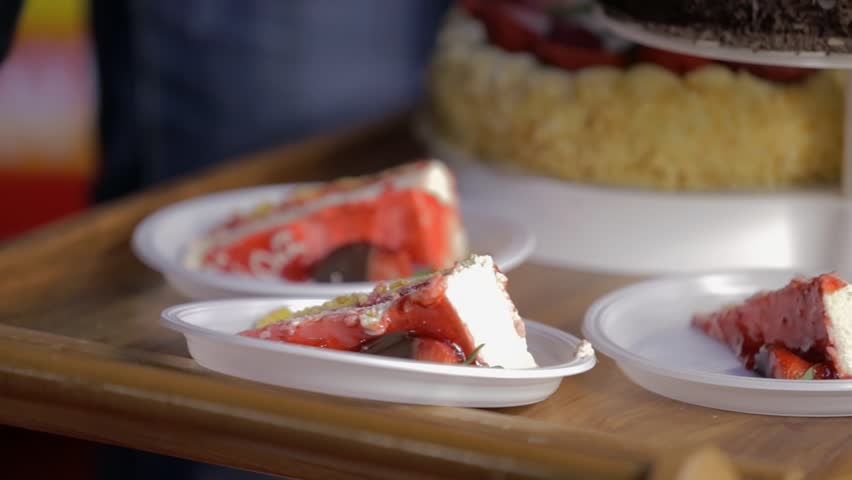 Cakes on white plastic plate wait to be picked up by guests | Shutterstock HD Video #6906649