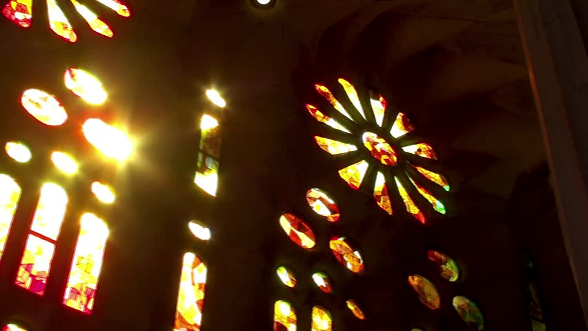 Sun light  passes through the stained glass windows of the church.