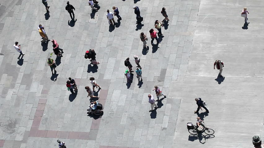 People walking on plaza in pedestrian zone - aerial top view