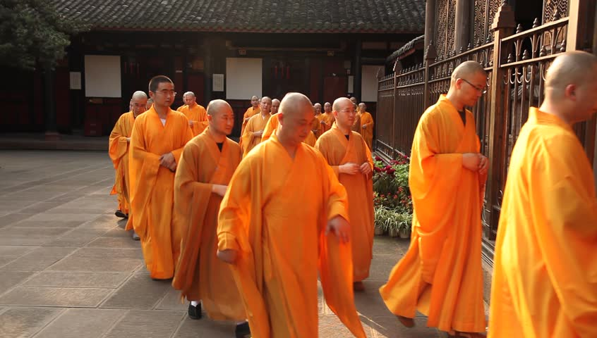 CHENGDU, CHINA - AUG 24: Monks enter Wenshu Temple after their daily procession, Chengdu, China, August 24, 2009.