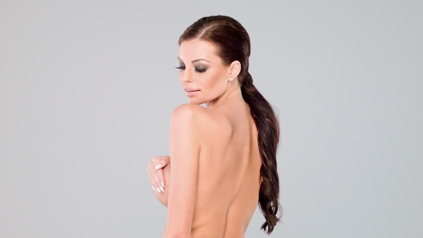 Attractive Naked Woman Looking At Camera. Closeup. Side