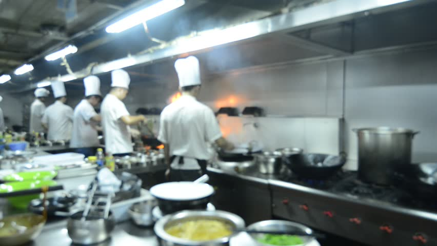 Restaurant Kitchen Photos blur background : chefs cooking food in a restaurant kitchen stock