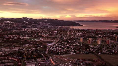 TRONDHEIM, NORWAY, JANUARY 2014 Aerial view over Trondheim, Norway, during a red sunset.
