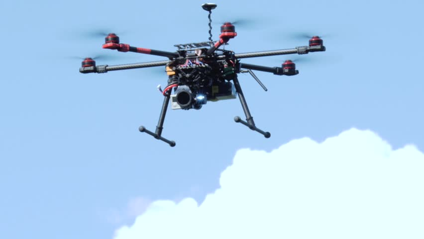 Professional drone flying in the air, in a aerial shot. | Shutterstock HD Video #7027279