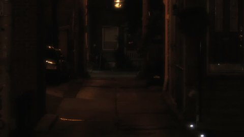 Establishing shot of a dark alleyway.