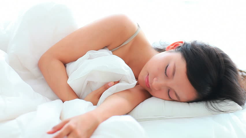 Young beautiful female having sleep troubles moving restless on young woman wake up smile at camera hd stock video clip ccuart Gallery