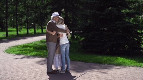 Granddaughter meeting her grandparents and greeting them with a sentimental squeeze