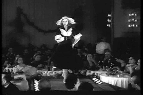 CIRCA 1950s - Italian fashion designers hold a fashion show displaying women's summer fashion in 1956.