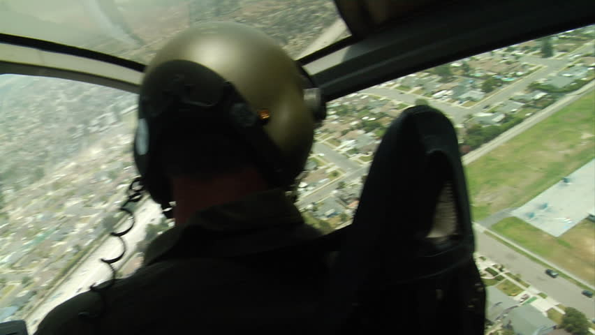 Helicopter Pilot flies over activity in Southern California