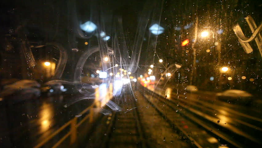 Tram's rear window view. Cold weather cityscape. Night time. Focus on window. Another tram passes by.  | Shutterstock HD Video #719149
