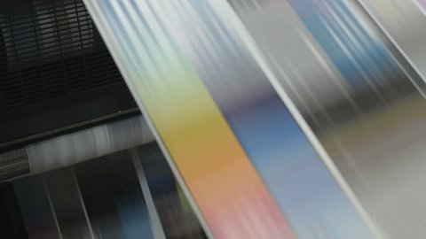 Fast moving paper on a roll in a printing factory