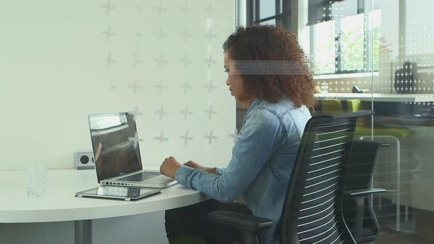 Businesswoman using laptop in office | Shutterstock HD Video #7224889