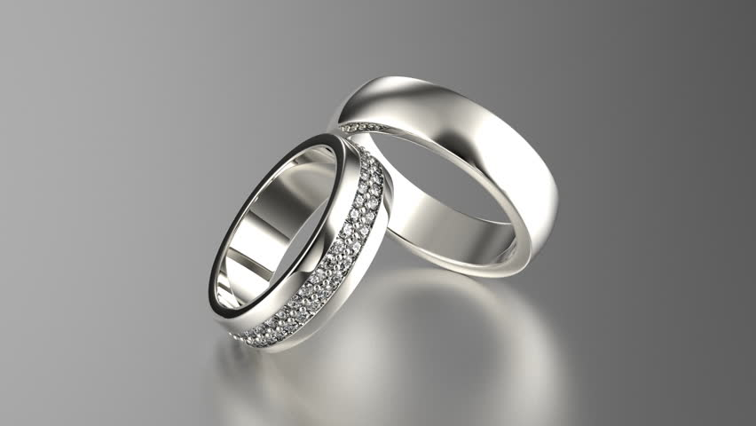 Two Silver Wedding Rings With Reflection Isolated On