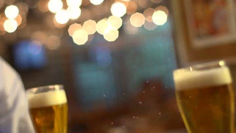 Stock video footage series clink glasses beer garden