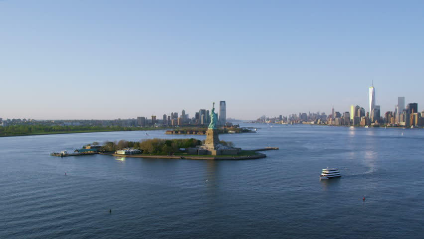 Helicopter aerial view of  Statue of Liberty, New York City State.  Flying overhead we see the iconic American Lady Statue. Famous United States tourism attraction.   Shutterstock HD Video #7244299