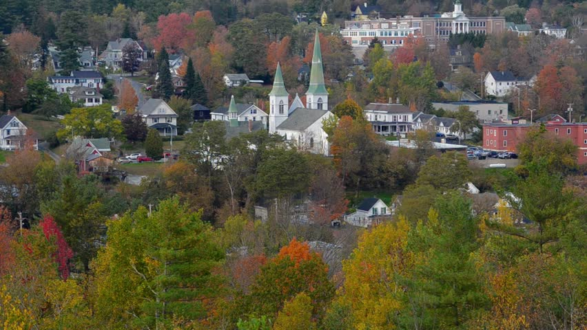 Littleton New Hampshire perfect New England town with fall foliage colors in October with steeple and town nestled in colorful leaves