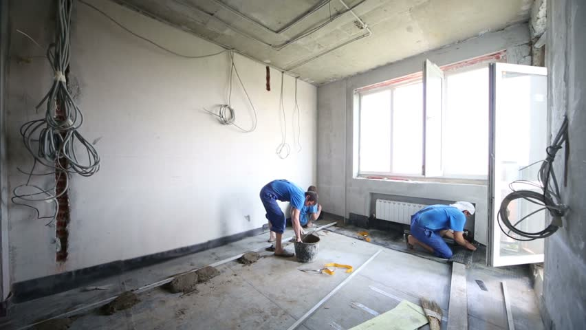 Two Men Work With Sound Insulation For Floor In Unfinished. Apartment Sound  Insulation Tips